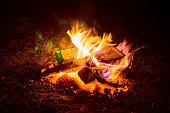 Beautiful night bonfire over Lemiet lake in Mazury district, Poland.