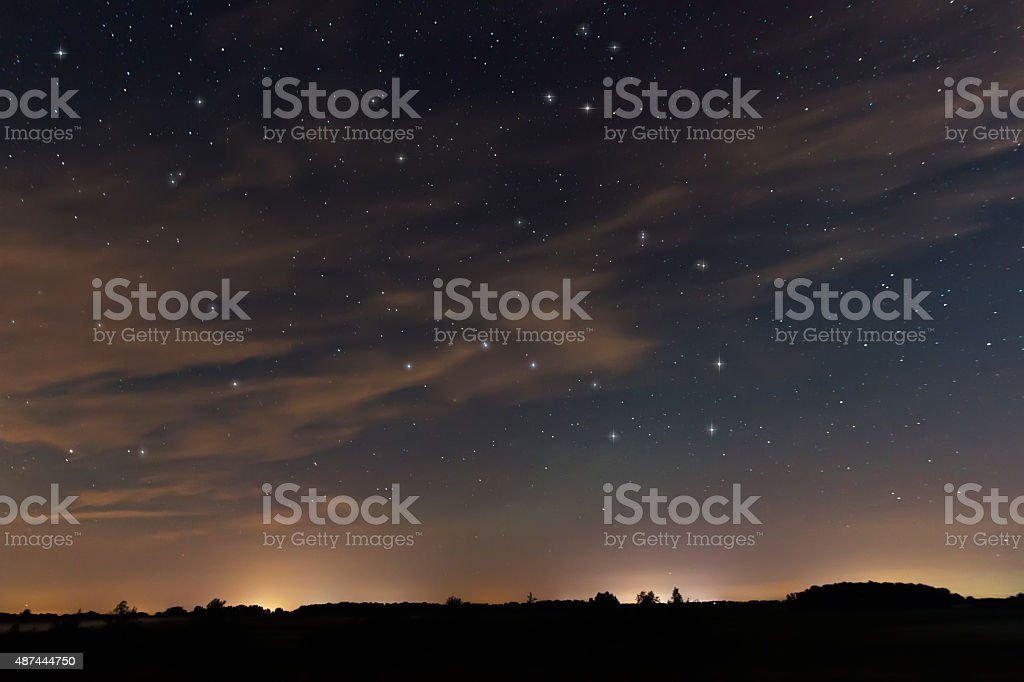 Beautiful night sky, with clouds and constellations stock photo