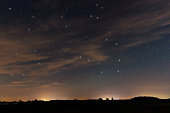 Beautiful night sky, with clouds and constellations