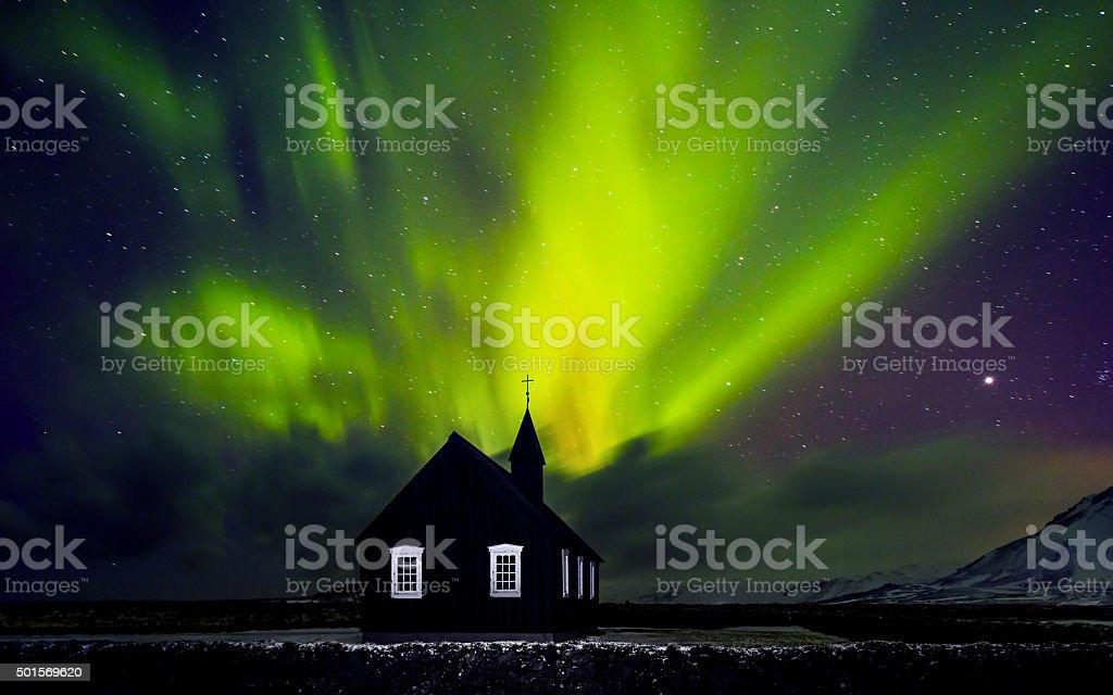 Beautiful Northern light over church stock photo