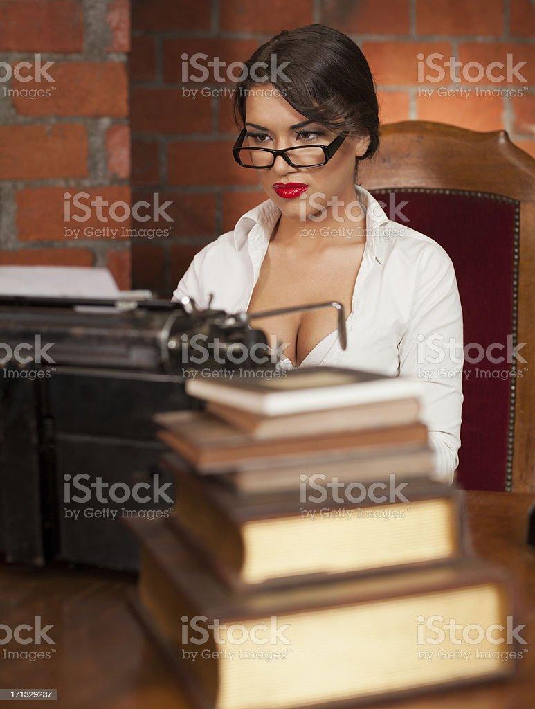 Beautiful novelist typing royalty-free stock photo