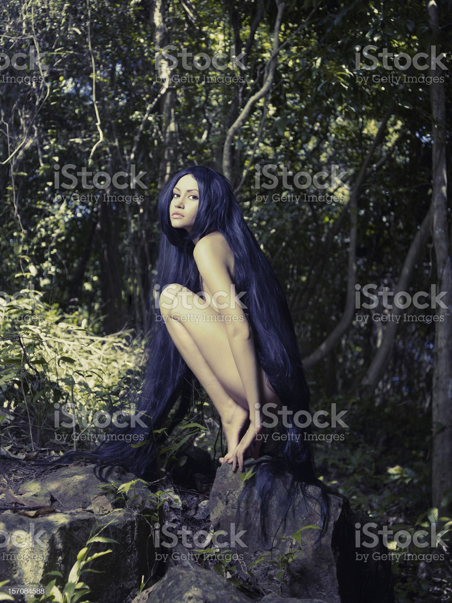 Beautiful nude lady in the rainforest royalty-free stock photo