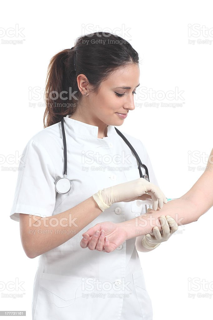 Beautiful nurse giving an injection royalty-free stock photo
