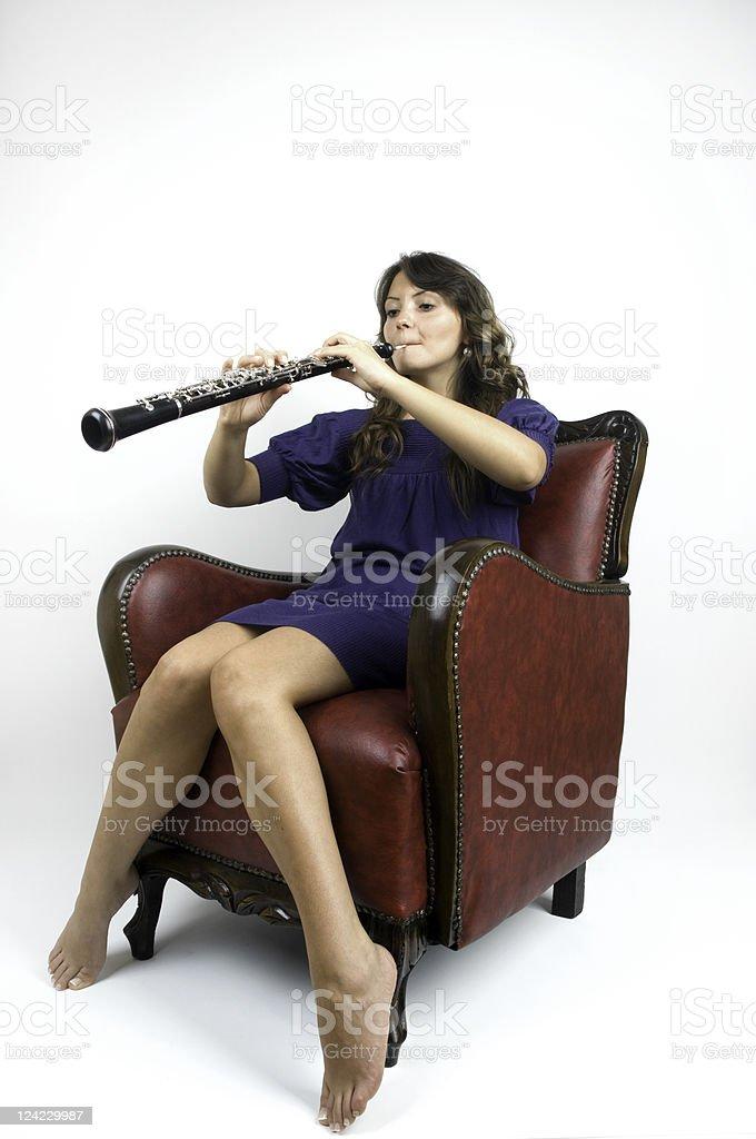 Beautiful oboist playing oboe stock photo