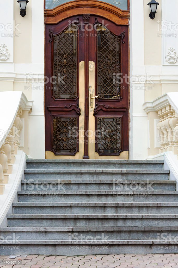 Beautiful old orante wooden door with steps and balustrade stock photo