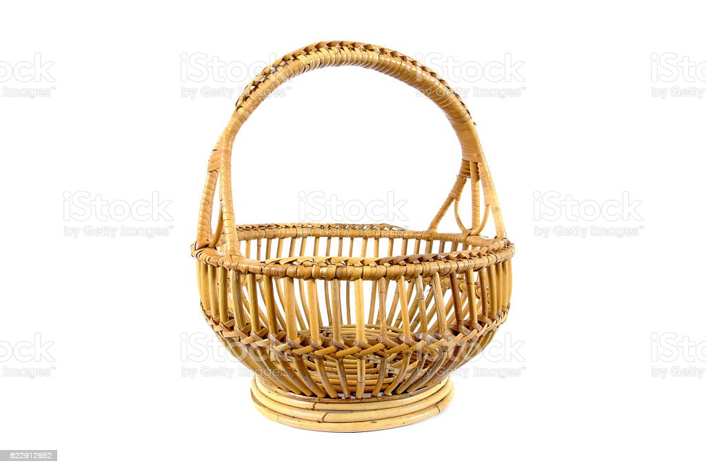 Beautiful old round rattan basket isolated on white background stock photo