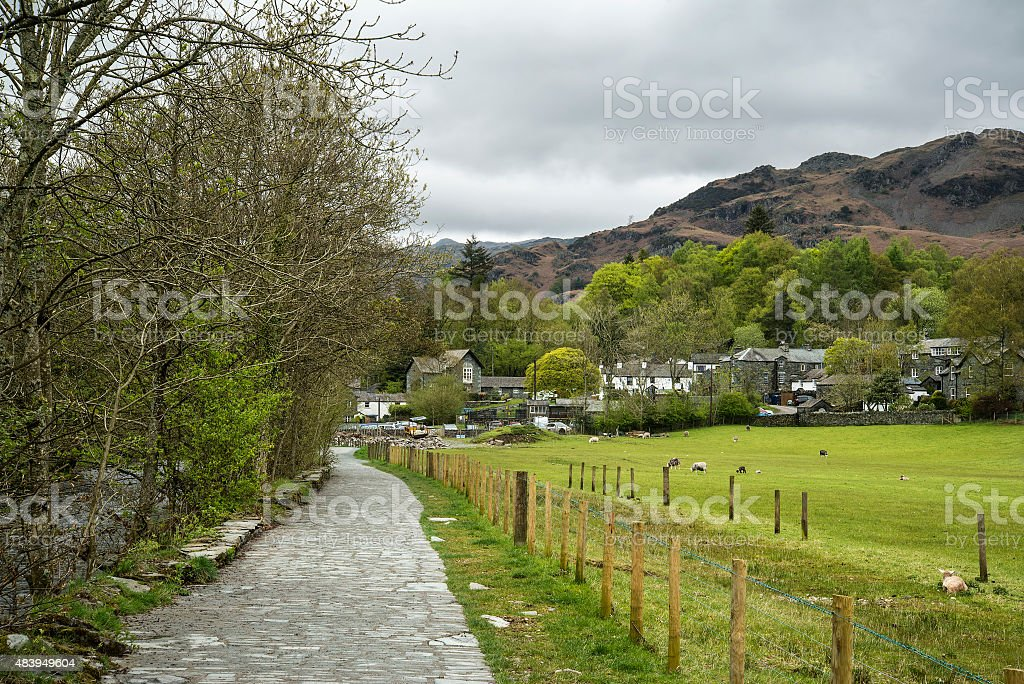 Beautiful old village landscape nestled in hills in Lake Distric stock photo