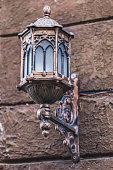 Beautiful old vintage metal lantern on the house wall. Handmade,