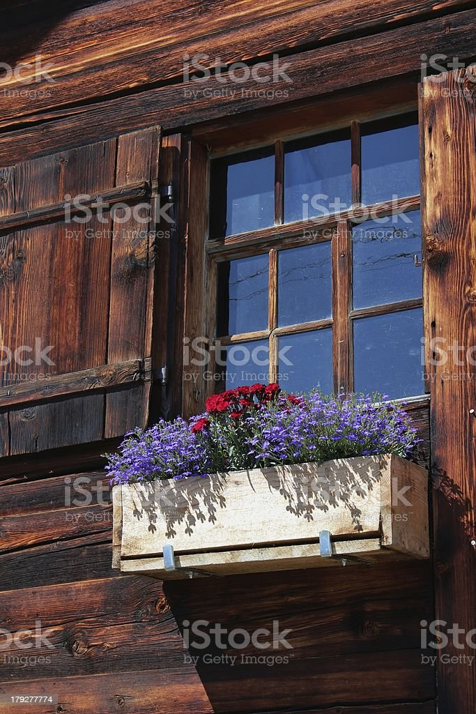 Beautiful old window decorated with flowers royalty-free stock photo