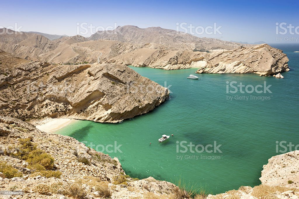Beautiful Oman Coast Green Lagoon with Hidden Beach stock photo