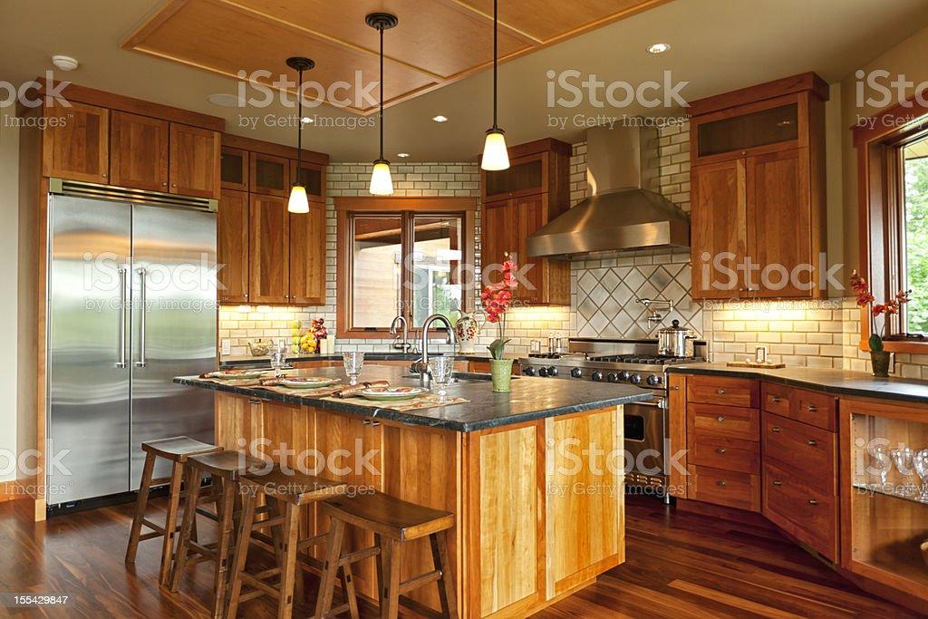 Beautiful Open Kitchen with Walnut Hardwood Floors royalty-free stock photo