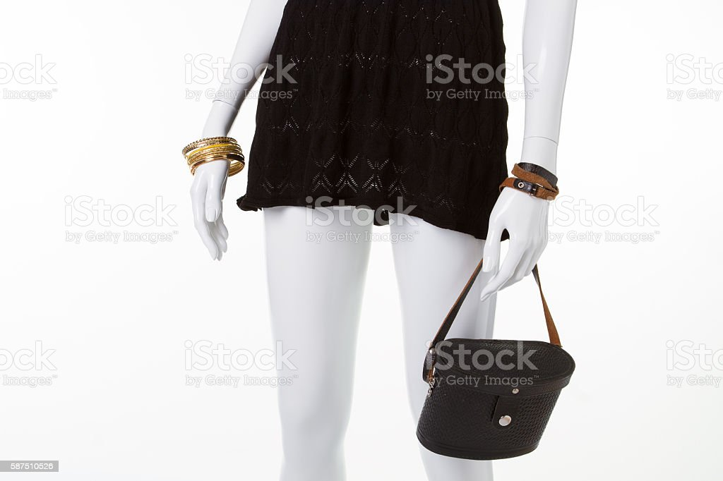 Beautiful openwork black dress with accessories. stock photo