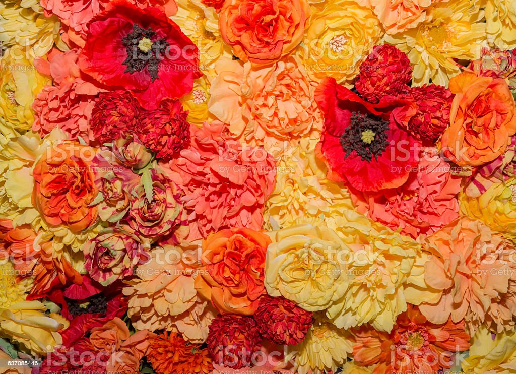 Beautiful orange artificial flowers background. stock photo
