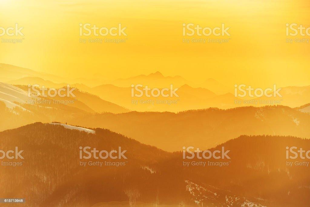 Beautiful orange sunset in mountains stock photo