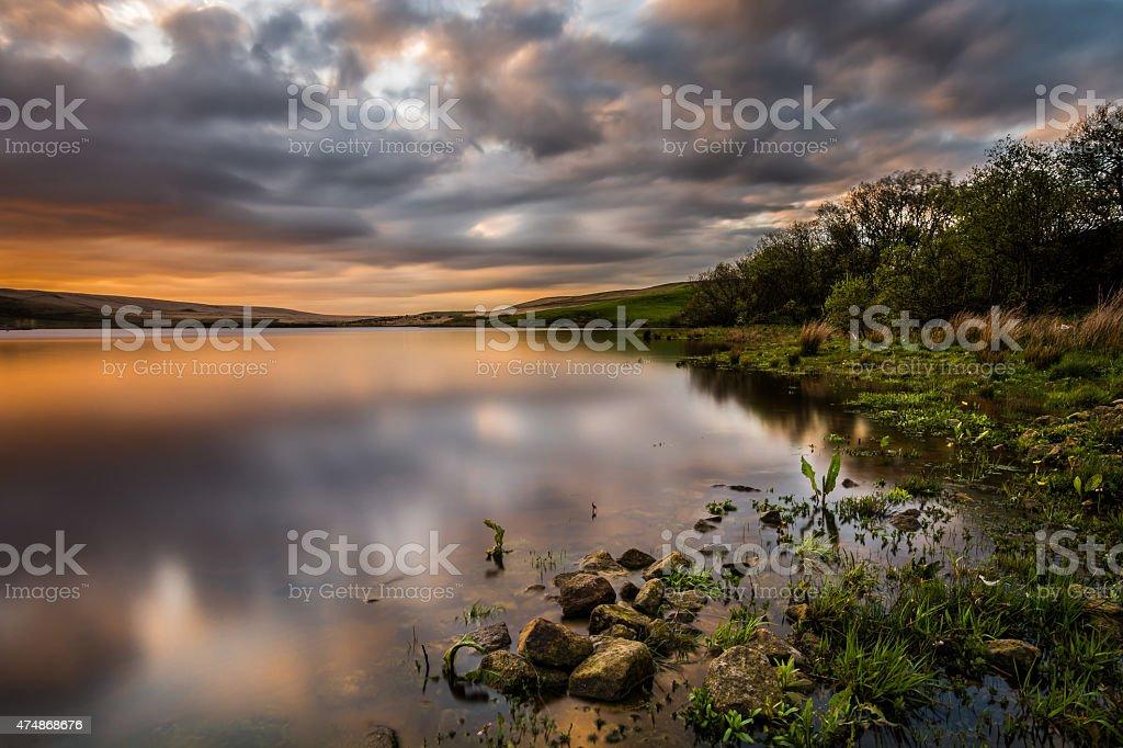 Beautiful Orange Sunset Over Calm Lake. stock photo
