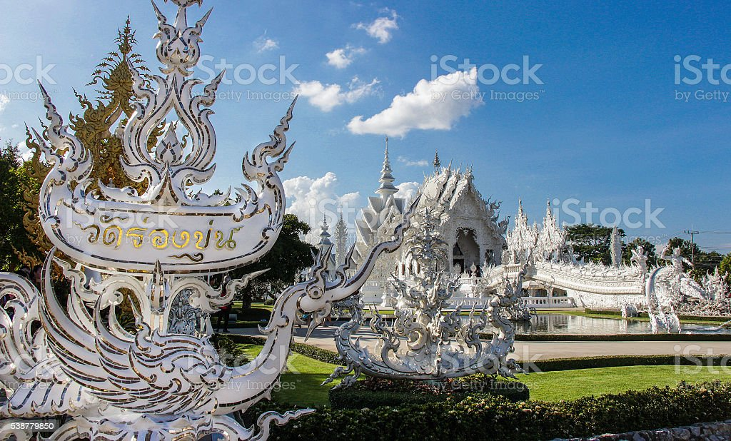 Beautiful ornate white temple located in Chiang Rai northern Thailand stock photo