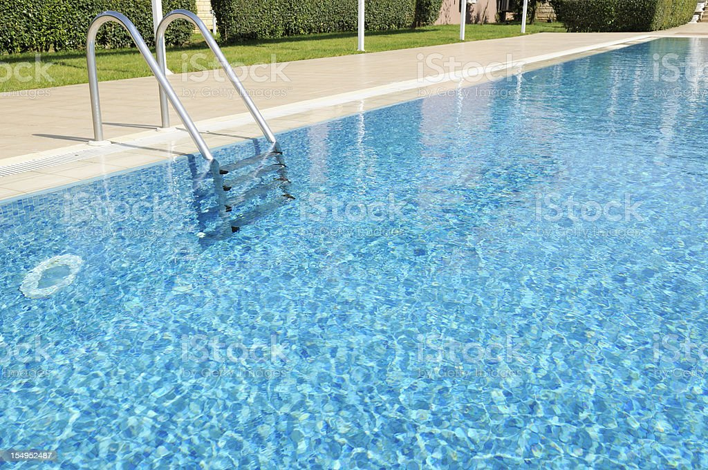 Beautiful Outdoor Hotel Swimming Pool in Sunshine royalty-free stock photo