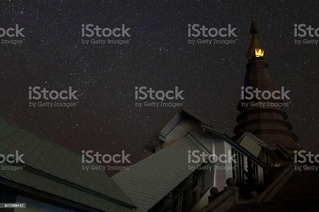 Beautiful pagoda buddhism in night sky with many stars stock photo