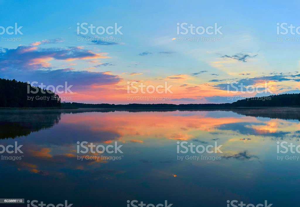 Beautiful panoramic view of the sunset over Lemiet lake in stock photo