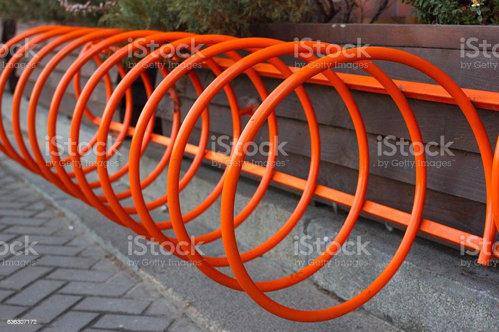 Beautiful parking for bicycles. Spiral orange in Kiev, Ukraine stock photo