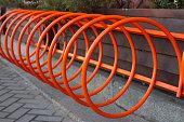 Beautiful parking for bicycles. Spiral orange in Kiev, Ukraine