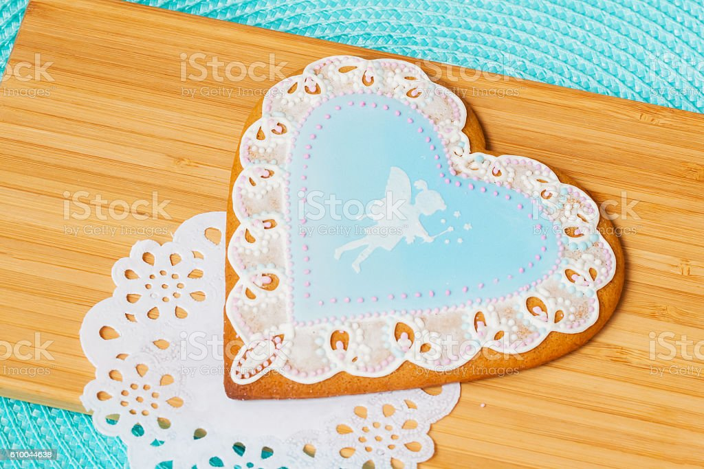 Beautiful pastel blue gingerbread with image of a cute little stock photo