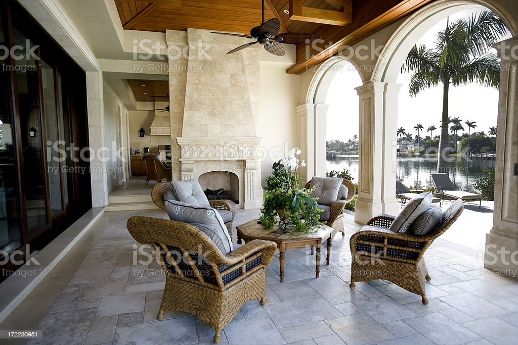 Beautiful Patio Furniture at Estate Home Overlooking Bay royalty-free stock photo