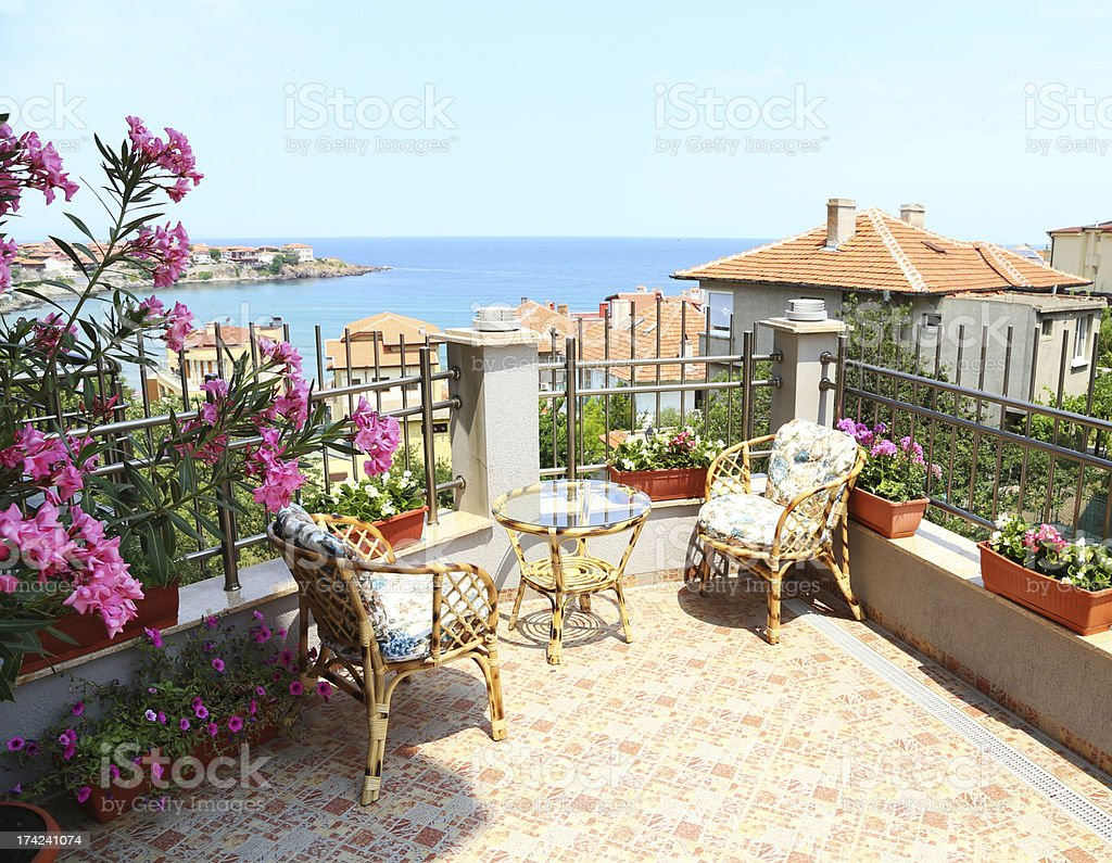 Beautiful patio surrounded by flowers royalty-free stock photo