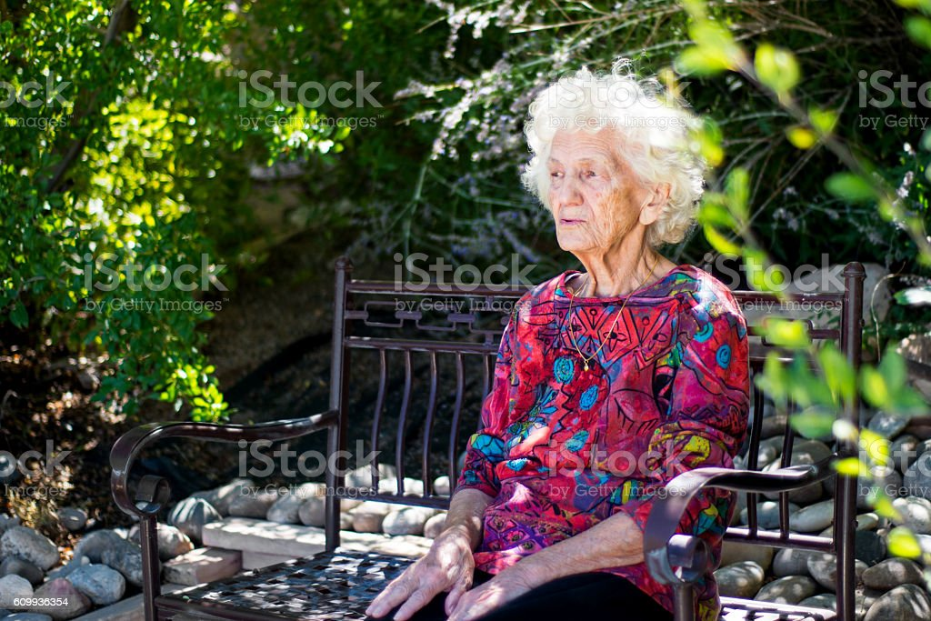 Beautiful Pensive Senior Woman Outdoors, Lost in Thoughts stock photo