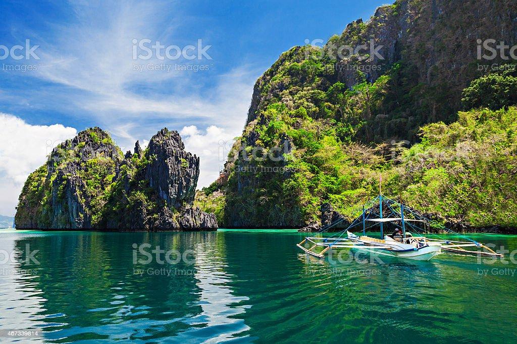 Beautiful photo of a boat sailing on a lagoon  stock photo