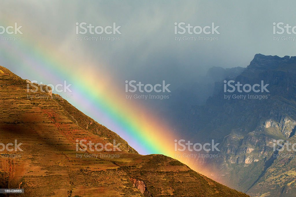 Beautiful picture of a rainbow on the mountains royalty-free stock photo