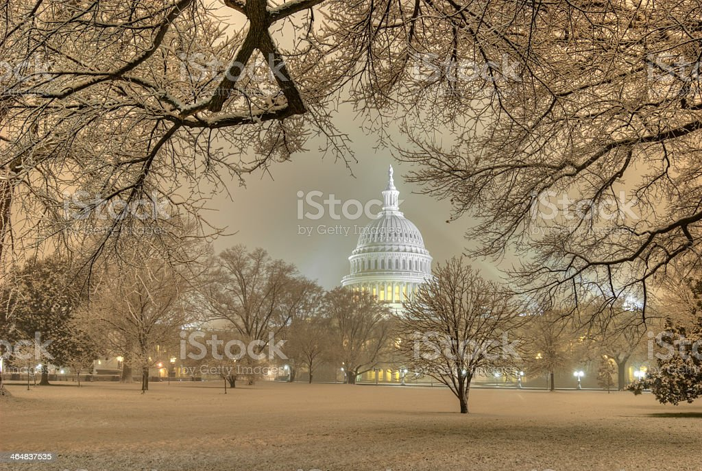 Beautiful picture of Capitol under a snowstorm stock photo