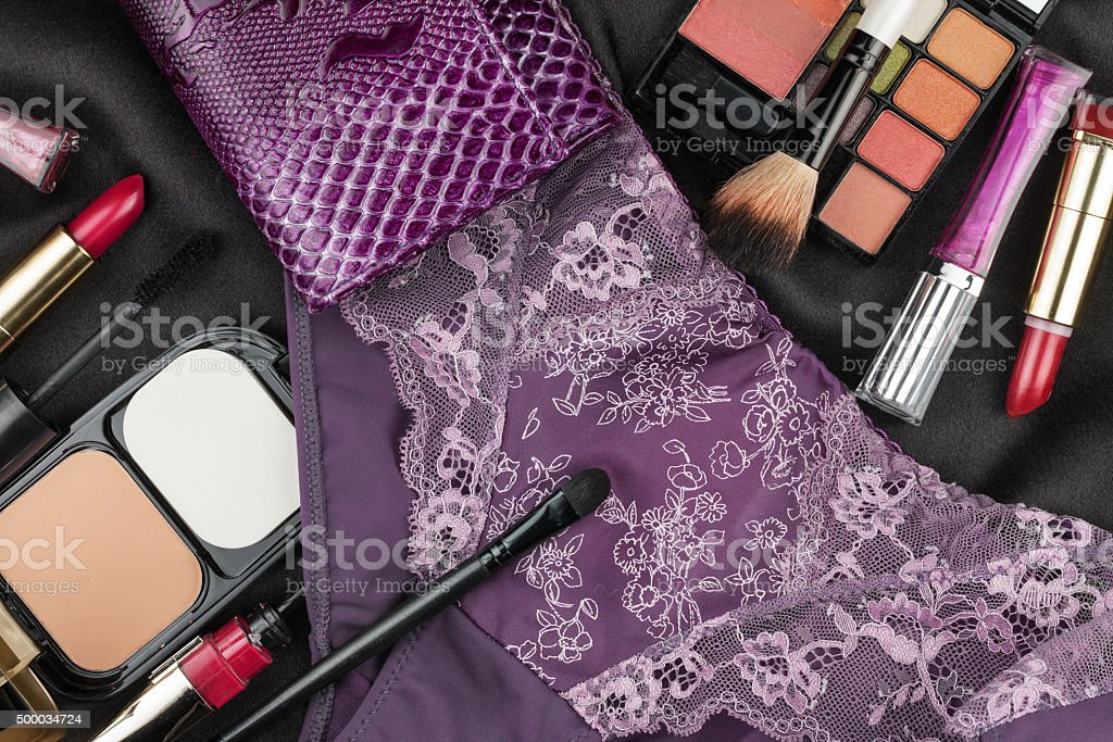 Beautiful picture of cosmetic and underwear on black silk stock photo