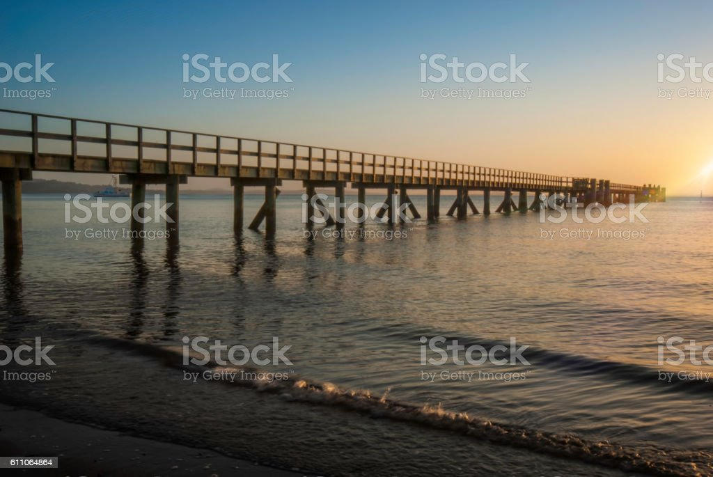 Beautiful pier with flare stock photo