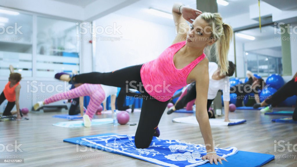 Beautiful pilates and fitness instructor stock photo