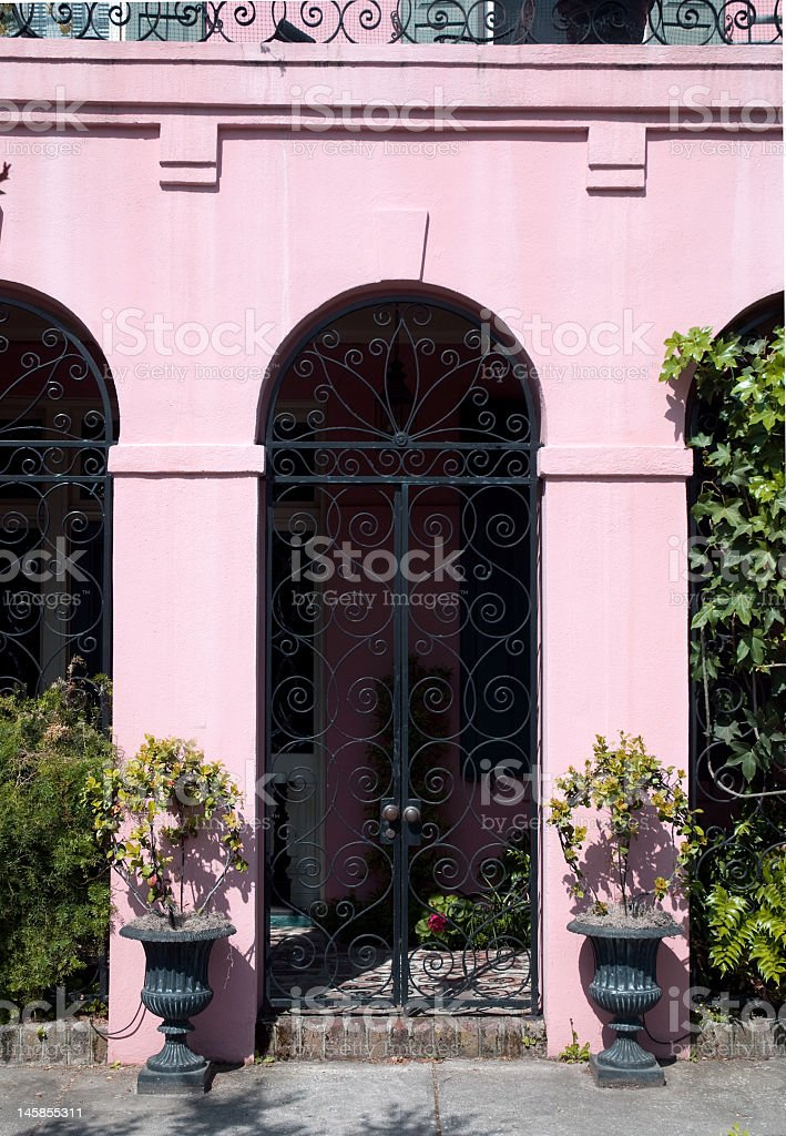 Beautiful Pink Archway With Wrought Iron Gate royalty-free stock photo
