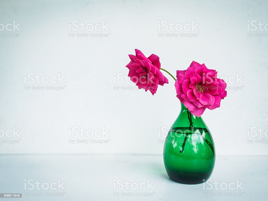 Beautiful pink flower in vase on table stock photo