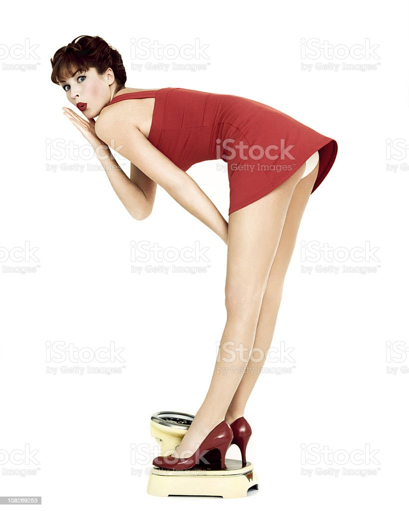 Beautiful Pin-Up Girl On A Weight Scale royalty-free stock photo