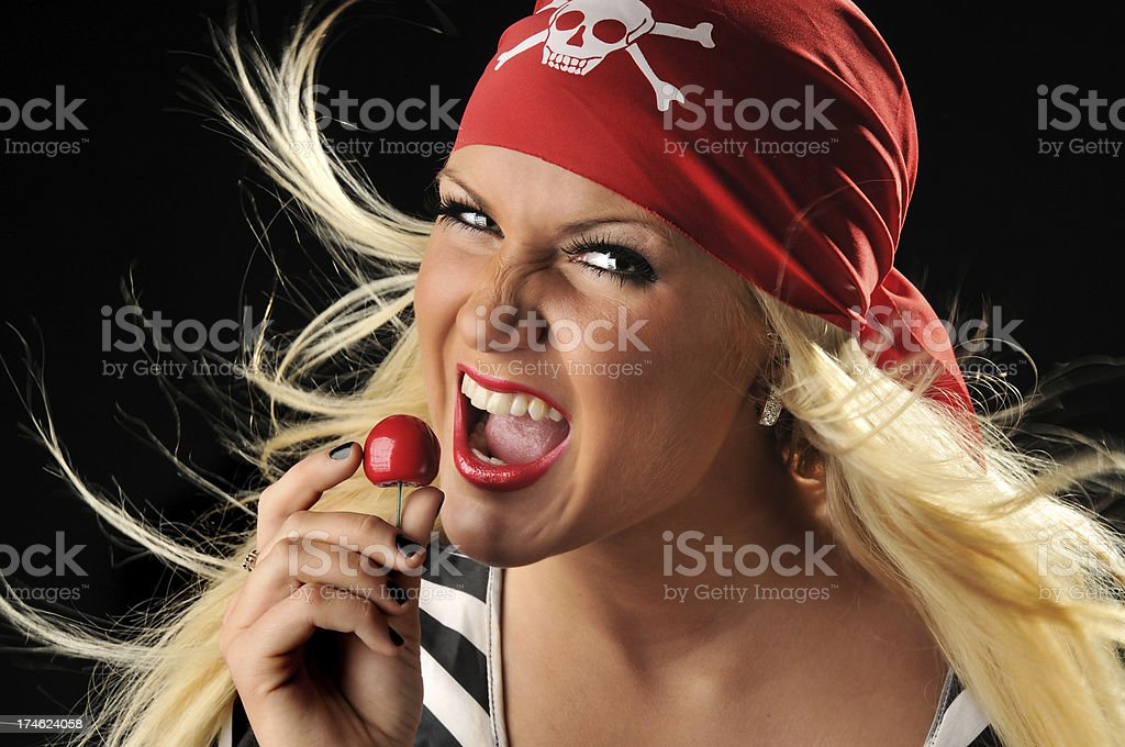 Beautiful pirate holding a cherry royalty-free stock photo