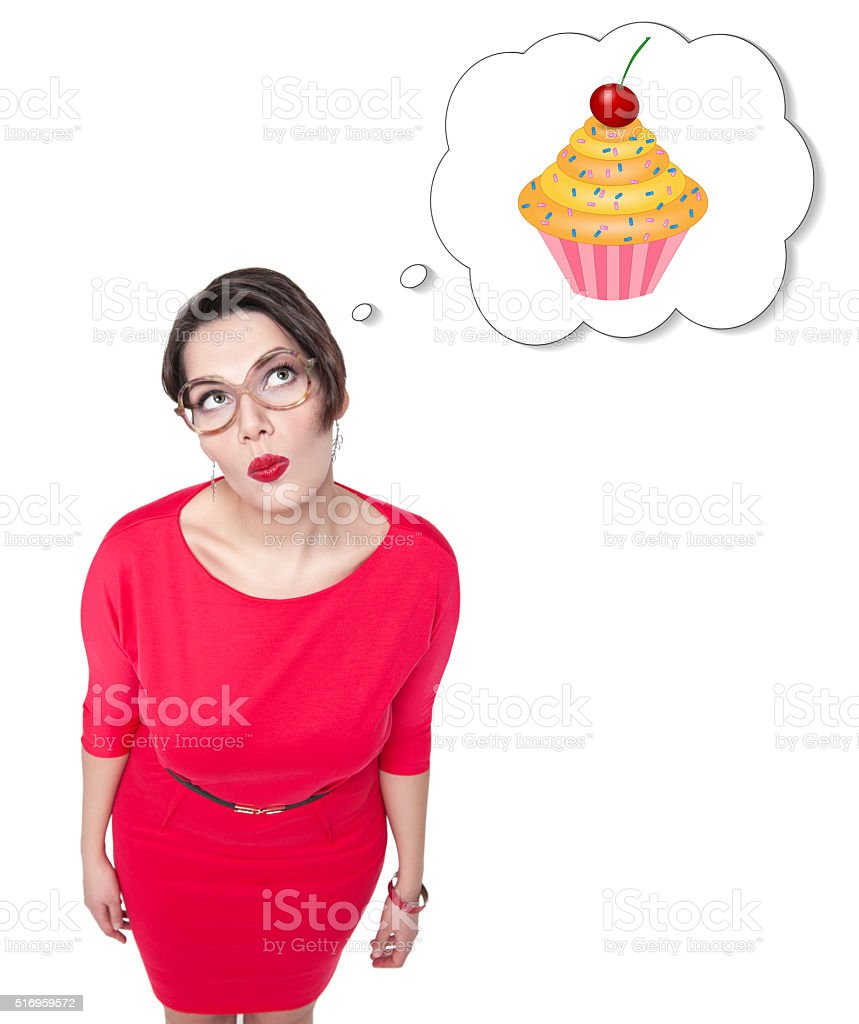 Beautiful plus size woman dreaming about cake stock photo