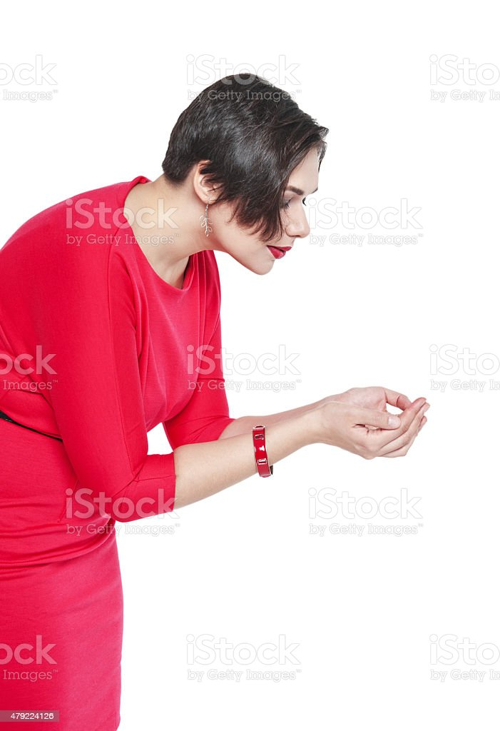 Beautiful plus size woman holding something in her hands stock photo