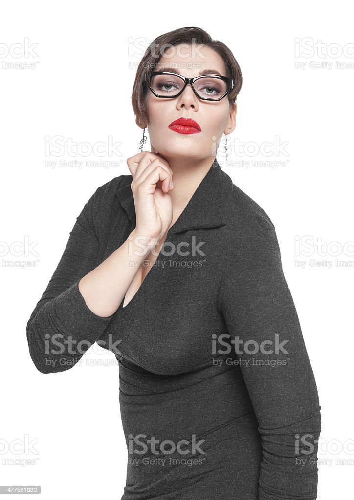 Beautiful plus size woman in black dress and glasses posing stock photo