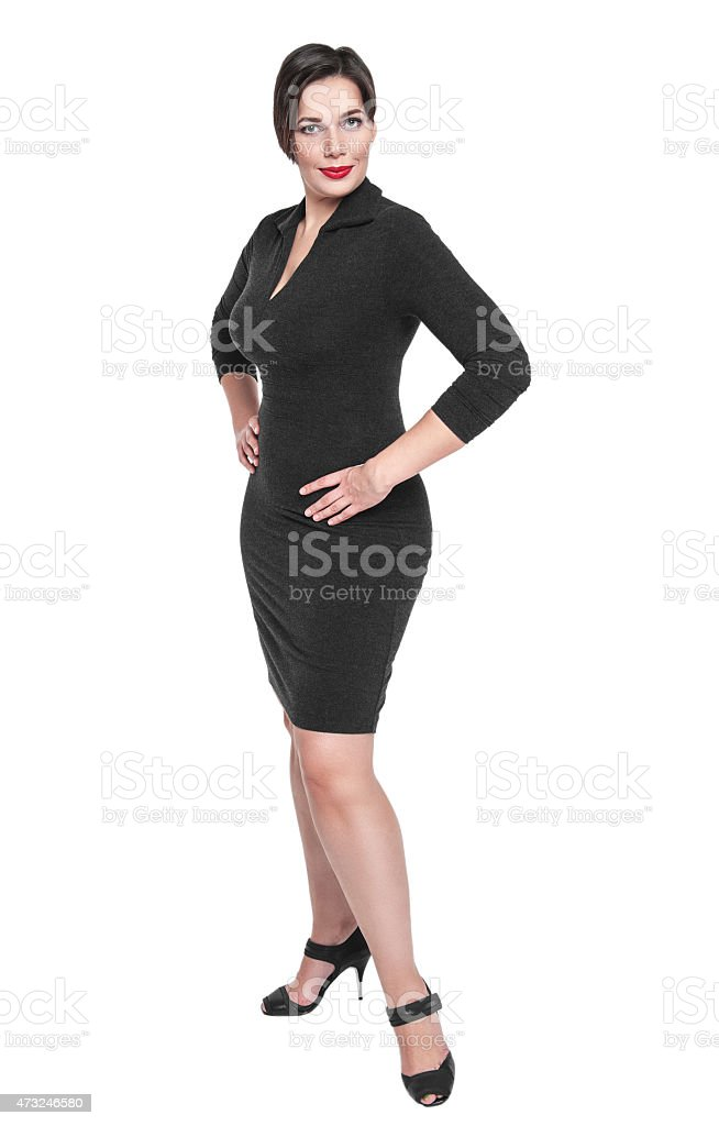 Beautiful plus size woman in black dress posing isolated stock photo