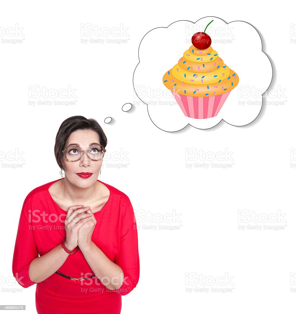 Beautiful plus size woman in red dress dreaming about cake stock photo