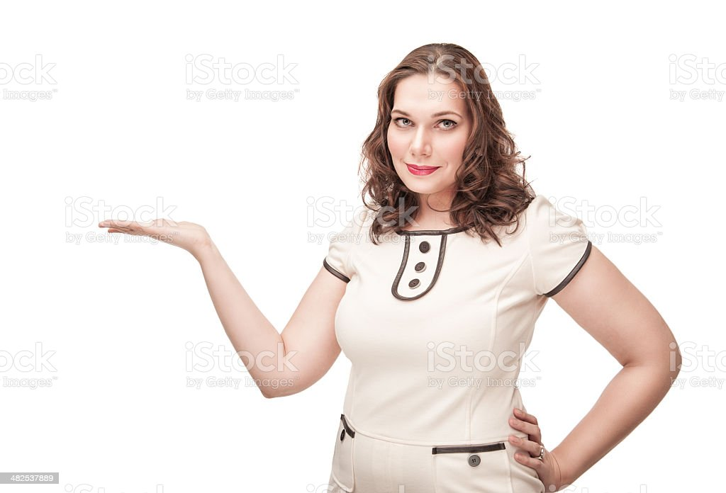 Beautiful plus size woman presenting on her empty palm stock photo
