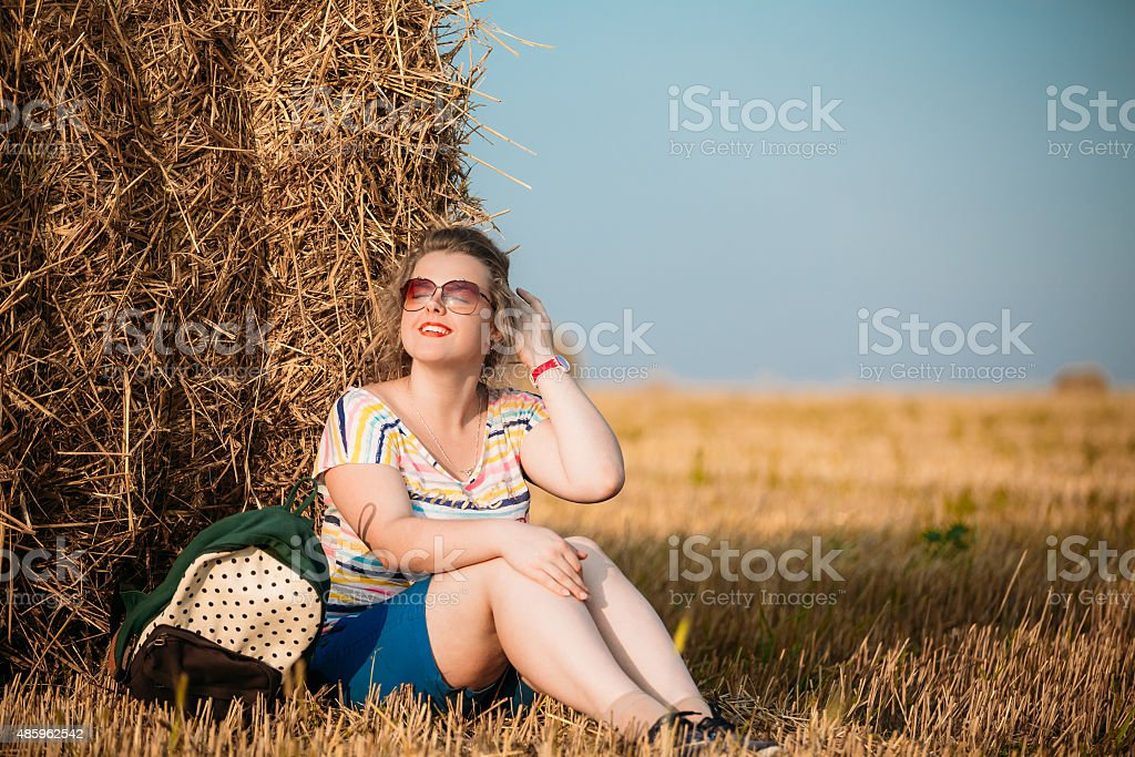 Beautiful Plus Size Young Woman In Summer Field stock photo