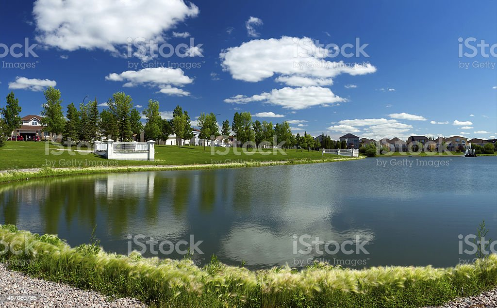 Beautiful pond in expensive neighborhood royalty-free stock photo
