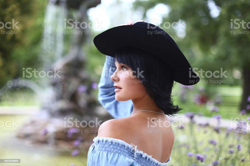 Beautiful portrait of cowgirl with black hat royalty-free stock photo