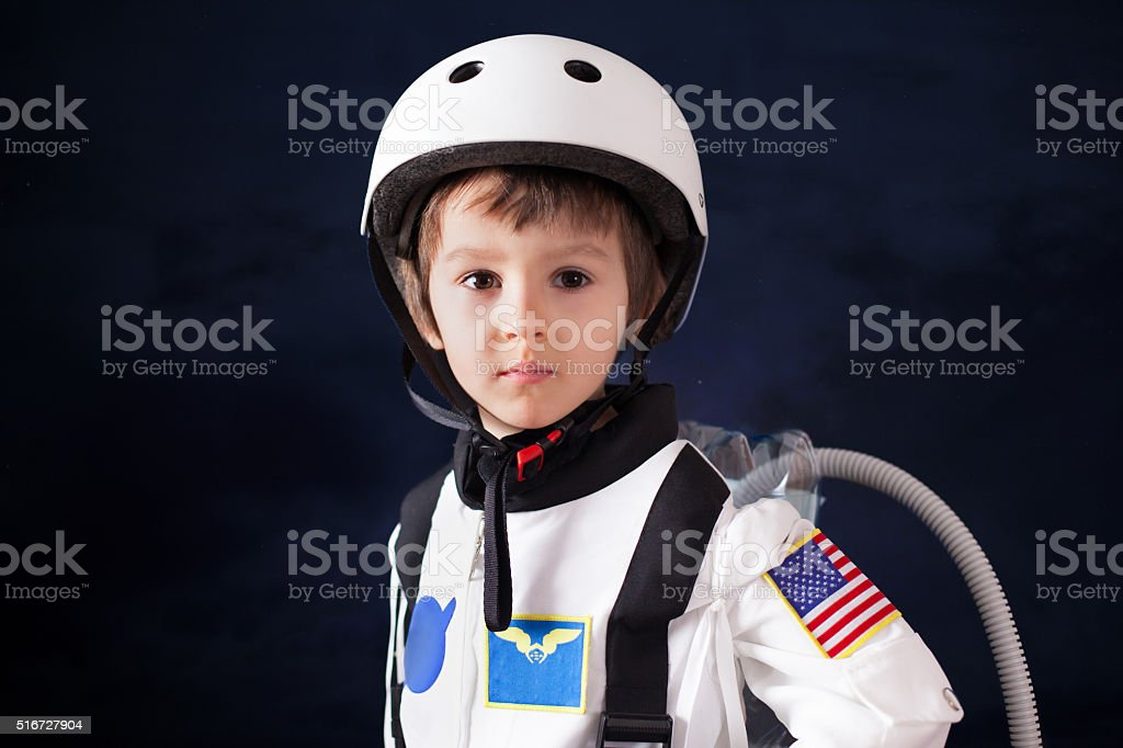 Beautiful portrait of preschool boy, dressed as astronaut stock photo