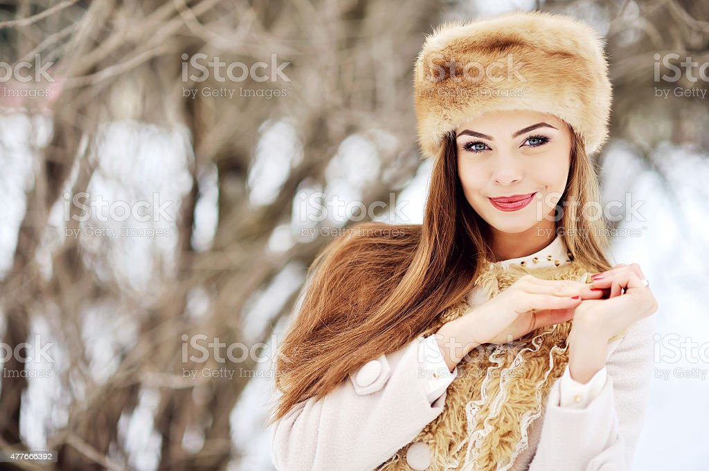 Beautiful portrait of young woman in winter stock photo